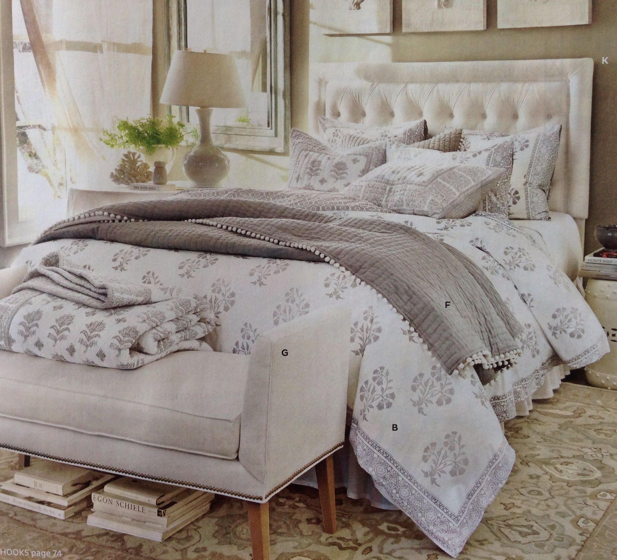 Love the headboard bench as footboard and use of rug to anchor the