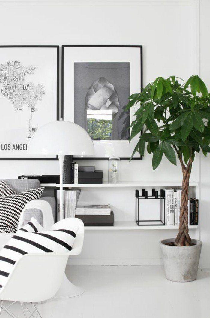 étagère basse suspendue et plante verte dans un intérieur monochrome