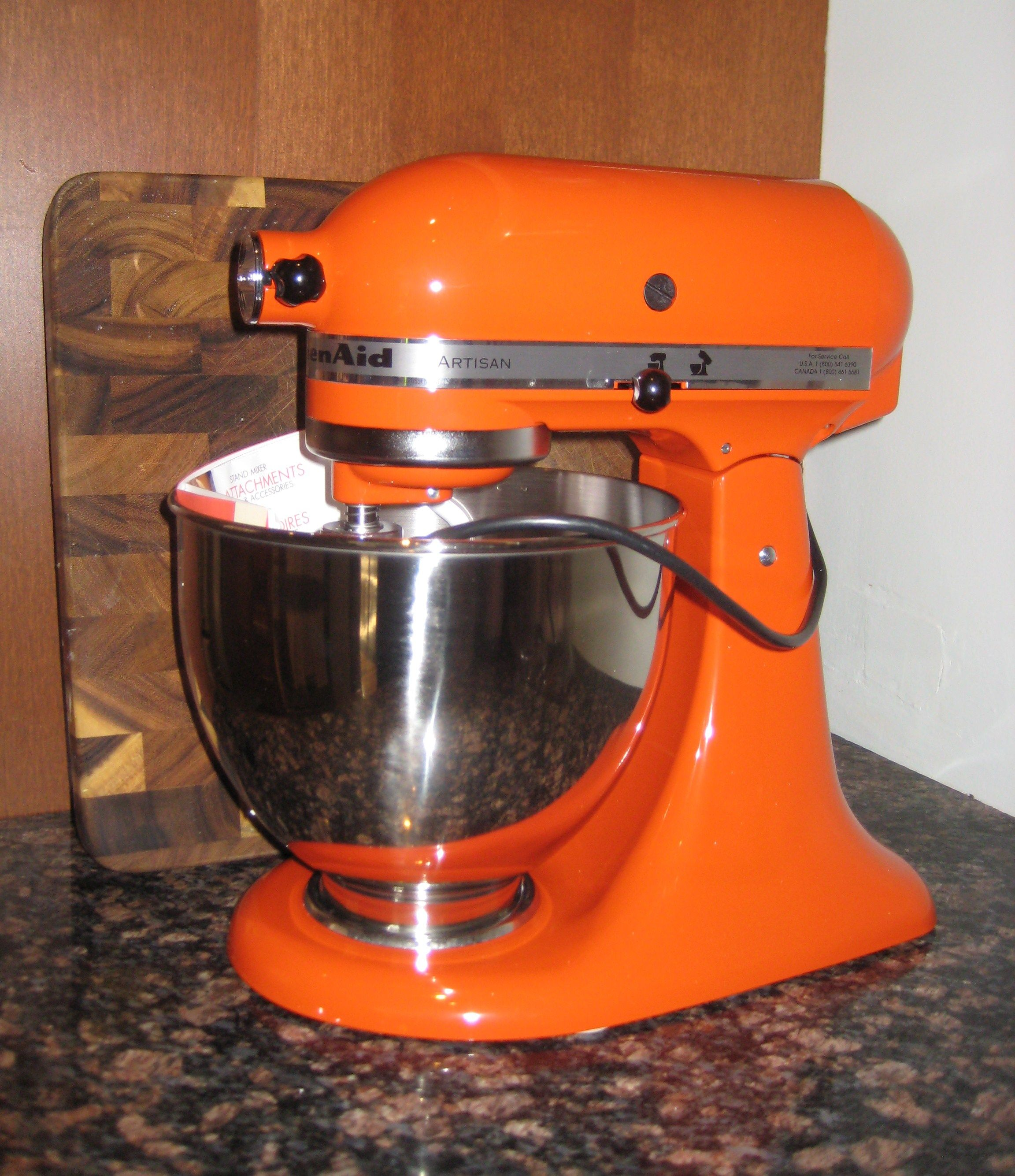 A Kitchenaid Mixer In Orange