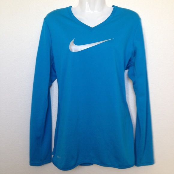 NIKE LARGE LING SLEEVE DRI FIT SHIRT Good condition size large Nike long sleeve shirt. A few stains on the right cuff please see photo. Great condition otherwise. Silver swish logo. Nike Tops Tees - Long Sleeve
