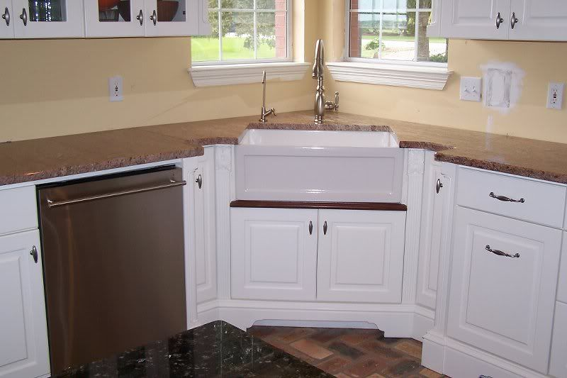 Oooh corner farmhouse sink for the home pinterest for Small kitchen designs with corner sinks