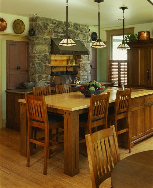 This is a great kitchen island idea with the bar seating all around