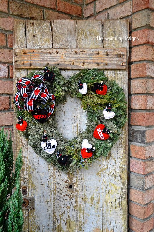 Valentine's Day Wreath - Housepitality Designs Prune Christmas wreath into heart shape and valentine embellishments