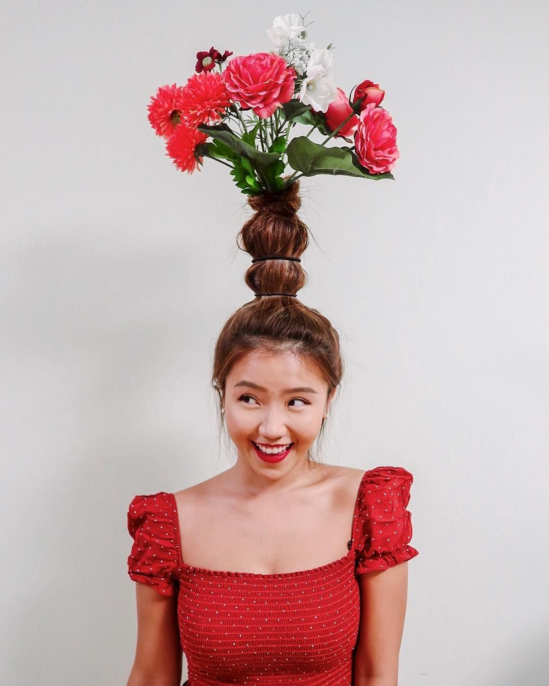 """Flower Vase Hair"" Has People Turning Their Locks Into Real Vases Atop Their Heads"