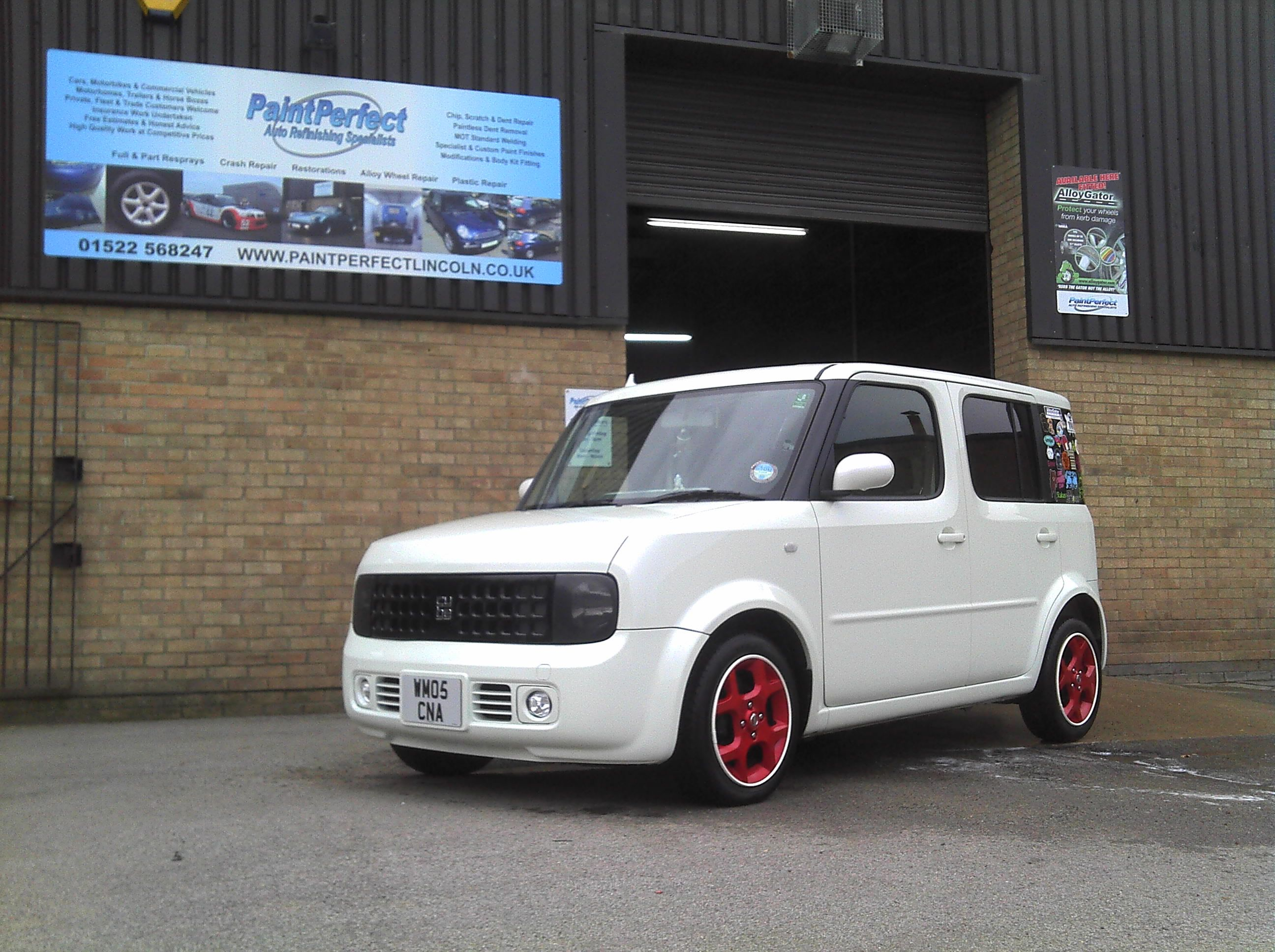 nissan cube with white alloygator wheel protectors fittedpaint