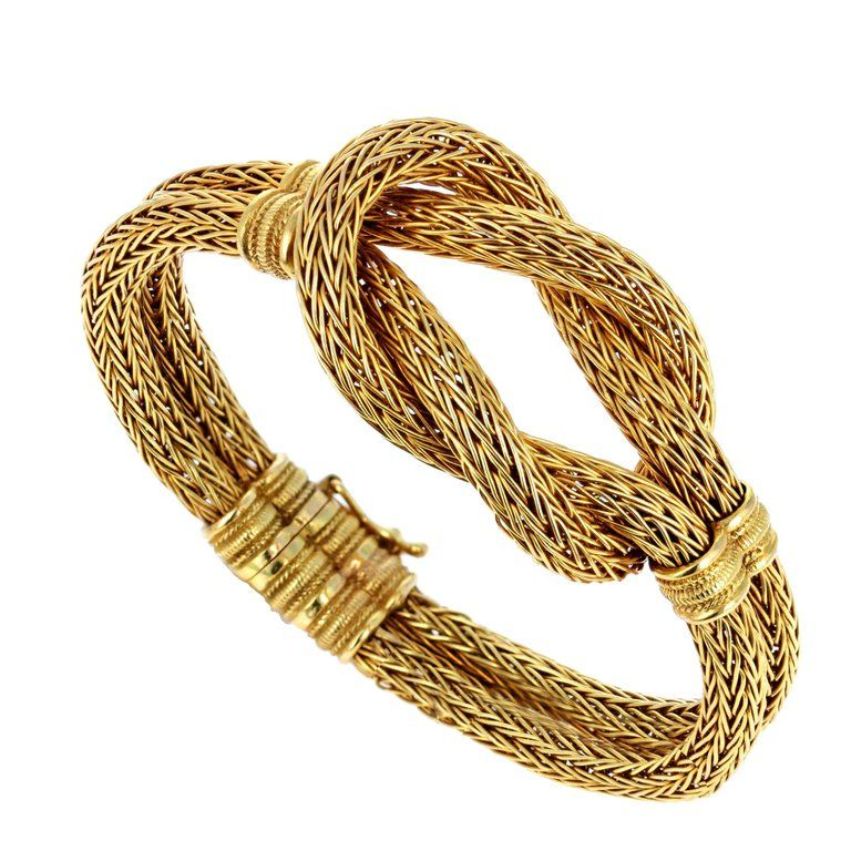 A Round Woven 18k Gold Chain Fashioned Into A Flexible Hercules