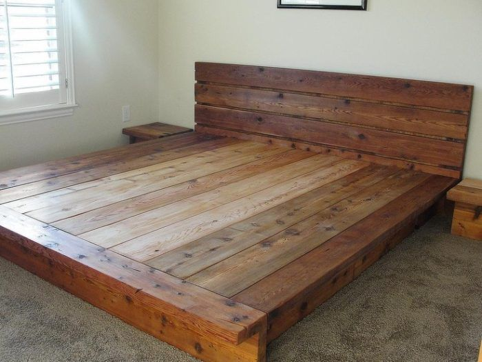 Wooden Platform Bed With Solid Lumber And Chunky Headboard Easily Large Enough To Provide Area For Storage Underneath Possibly Larger Than Mattress
