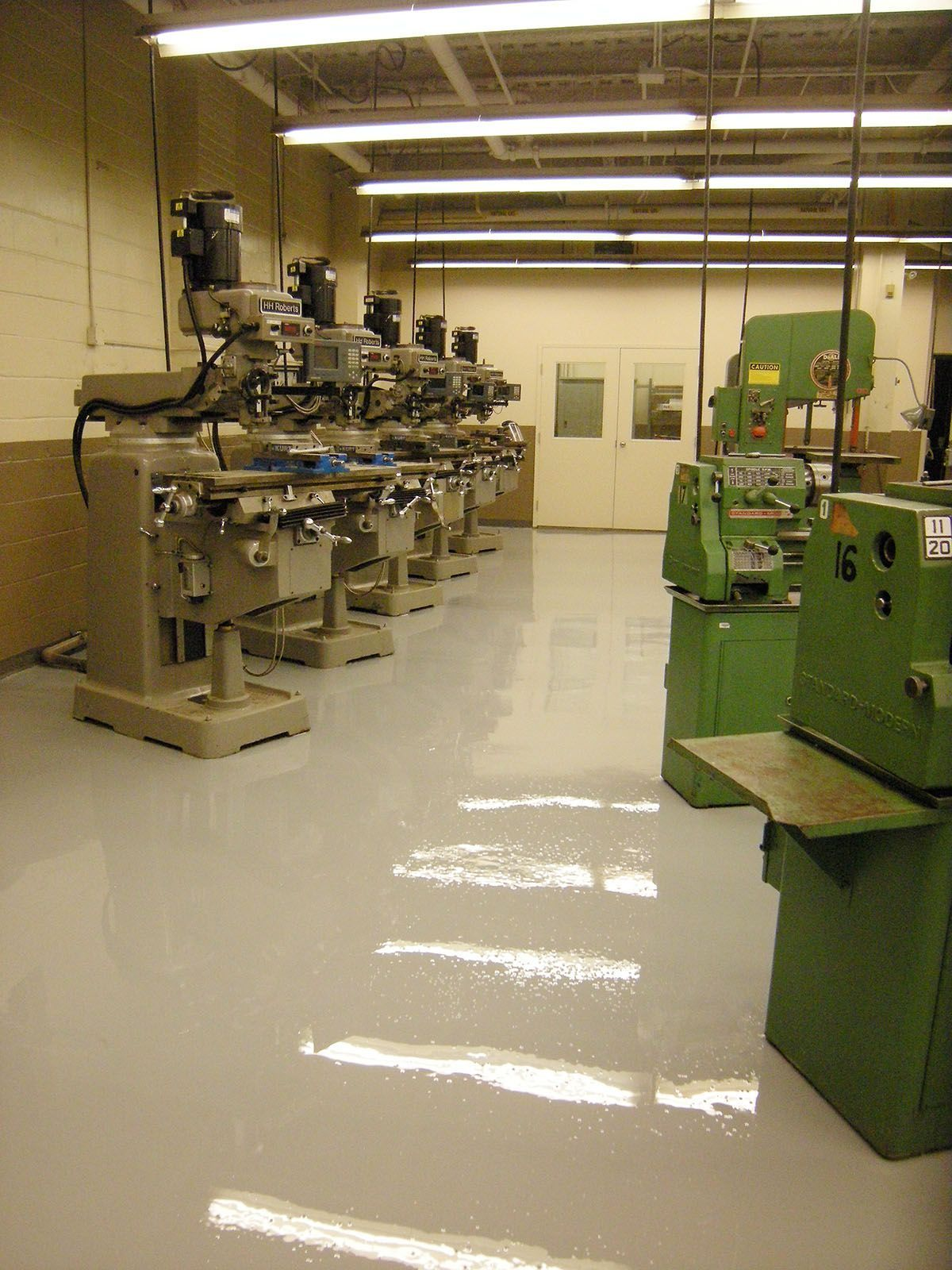 Gray epoxy floor in the machine shop for Brown
