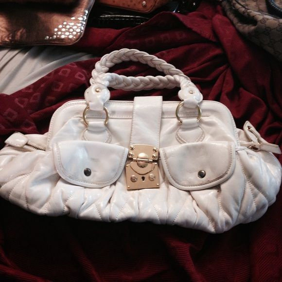 """LOVELY CREAM HANDBAG Gold hardware minor imperfections as indicated in pic no 3.......measurements are 18"""" X 9"""" Bags"""