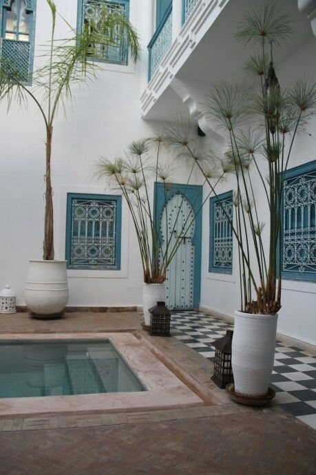 Cement tiles under balcony - Moroccan riad courtyard. Fresh and light in white and turquoise blue.