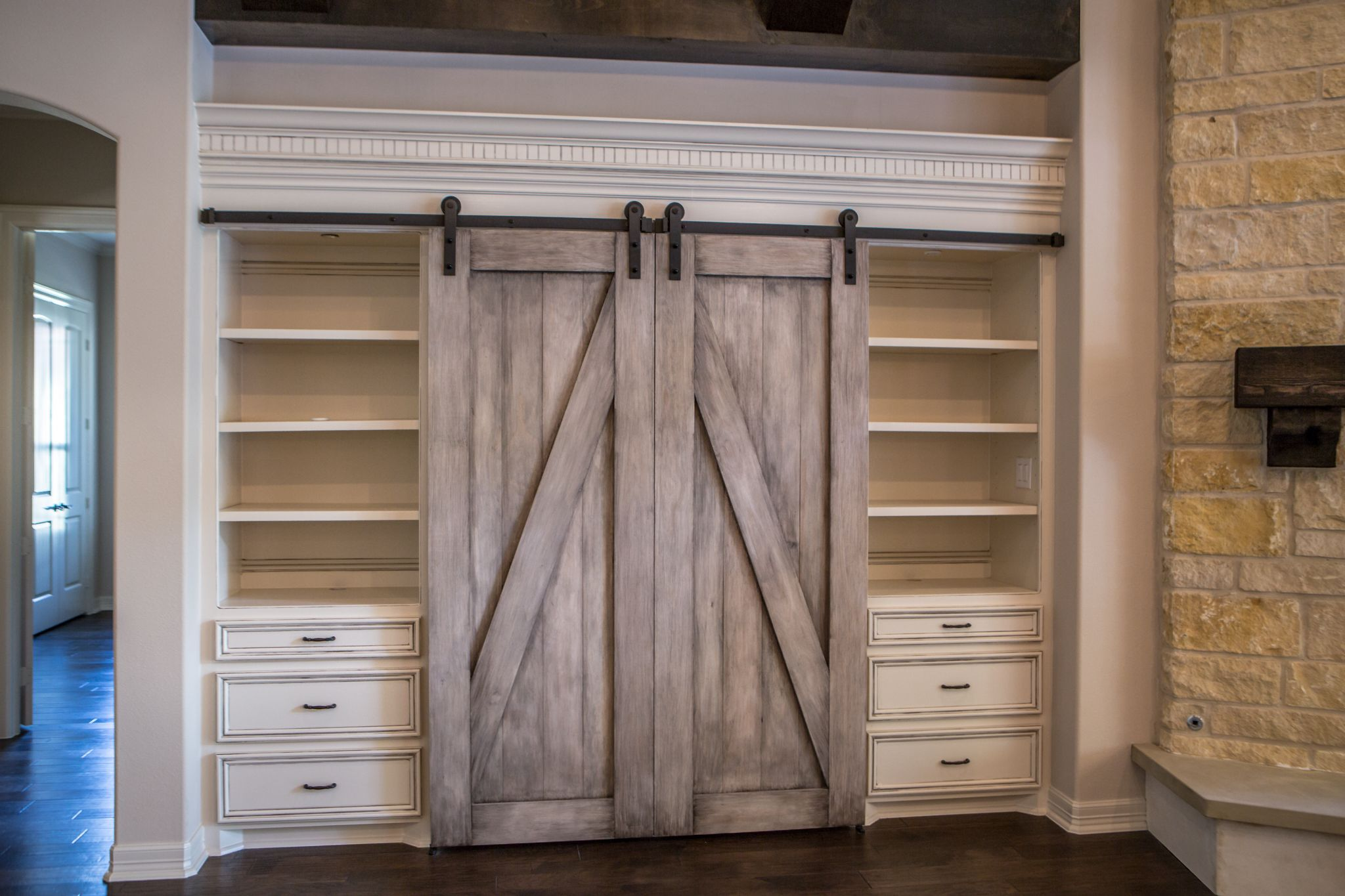 Beautiful Built In Entertainment Center With Barn Doors To Hide