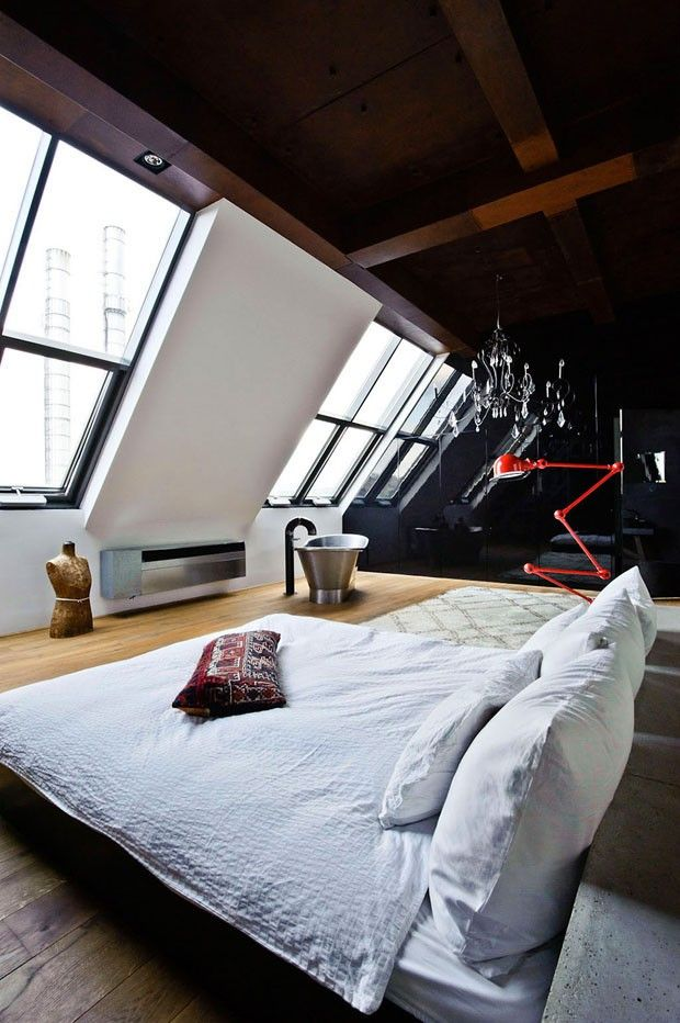Industrial loft space with low bed and