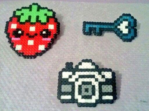 Hama fruta, cámara y llave.