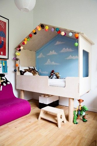 modern cubby bed with painted wall and fairy lights in childs