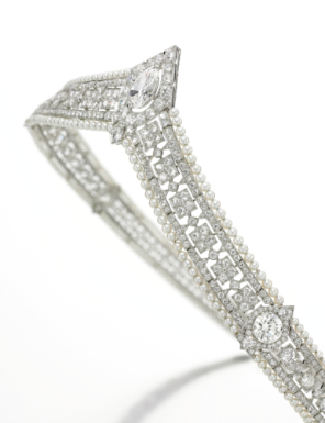 Seed pearl and diamond bandeau tiara, made in 1915. It is set at the center with a pear-shaped diamond, and is further accented with circular- and single-cut diamonds. The diamonds are arranged in a simple, geometric pattern; bordered by seed pearls on both the top and bottom. - Sotheby's