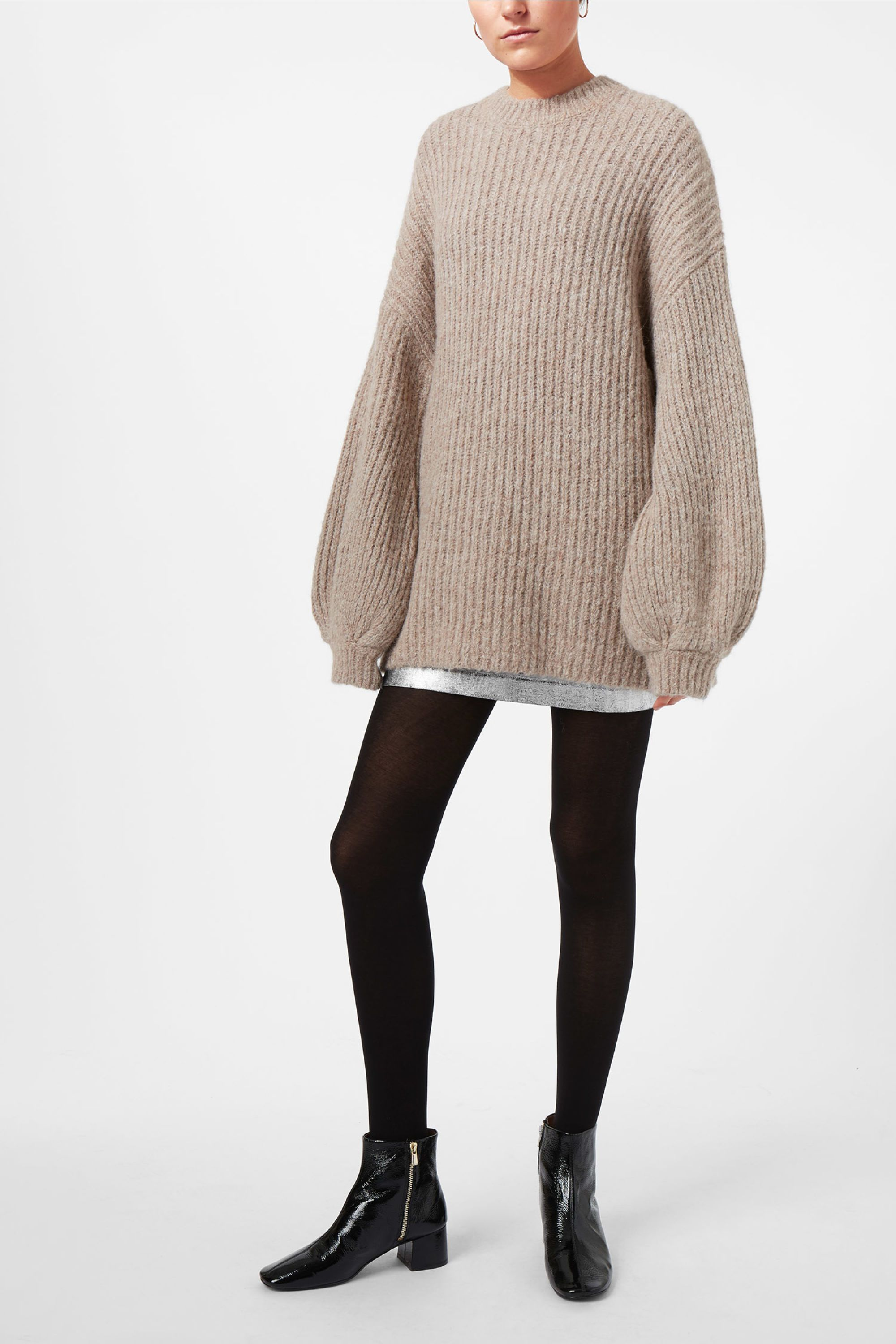 <p>The Tiziana Sweater is a cold-season essential, knitted in a chunky ribbed wool blend. This oversized sweater has a banded crewneck, dropped shoulders an