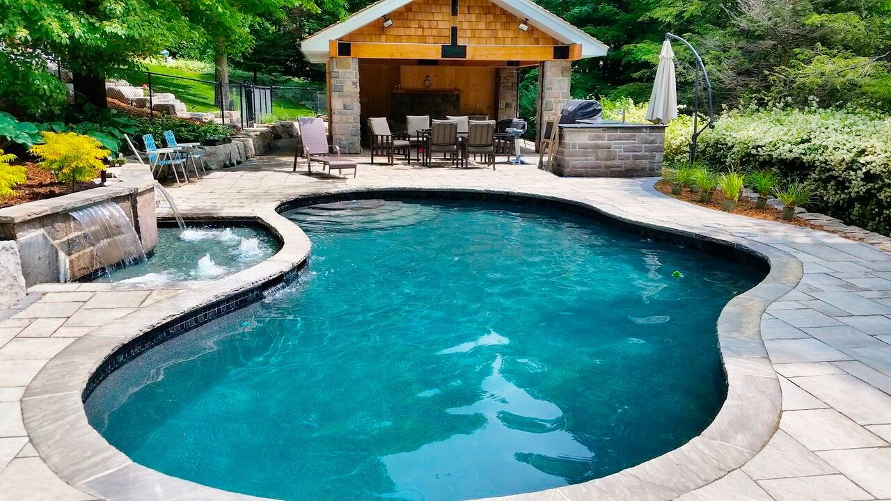 Architecture Awesome Backyard Design With Modern Kidney Shaped Pool Feat Small Fountain Also Concrete Pool Deck Near Small Patio Design Backyard Archi Cool Ideas