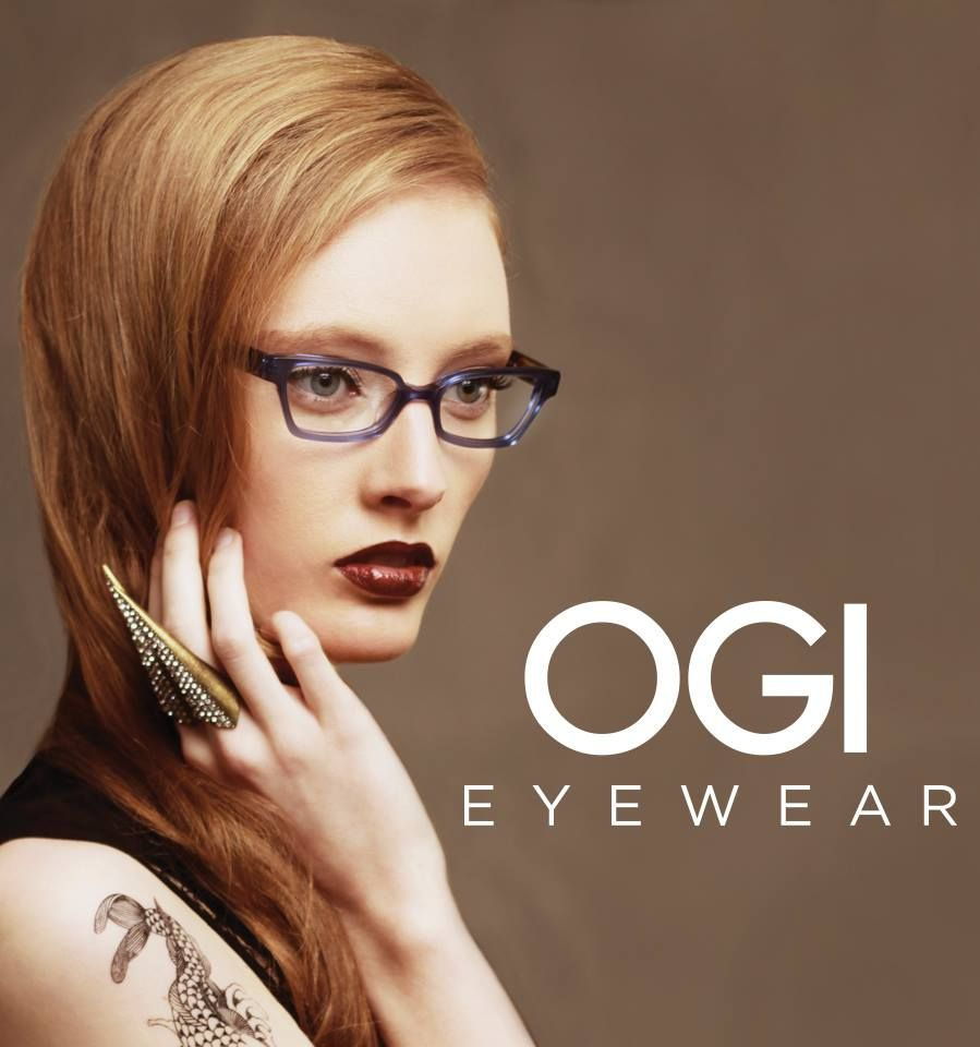 @Ogi Eyewear's 7148 features a matte translucent front which bonds beautifully with boldly colored camouflage temples. The smoothly carved bridge and slight cat eye silhouette give the 7148 a feminine sophistication with a vibrant attitude.  Our model looks ravishing in blue (7148-1467). | #mido