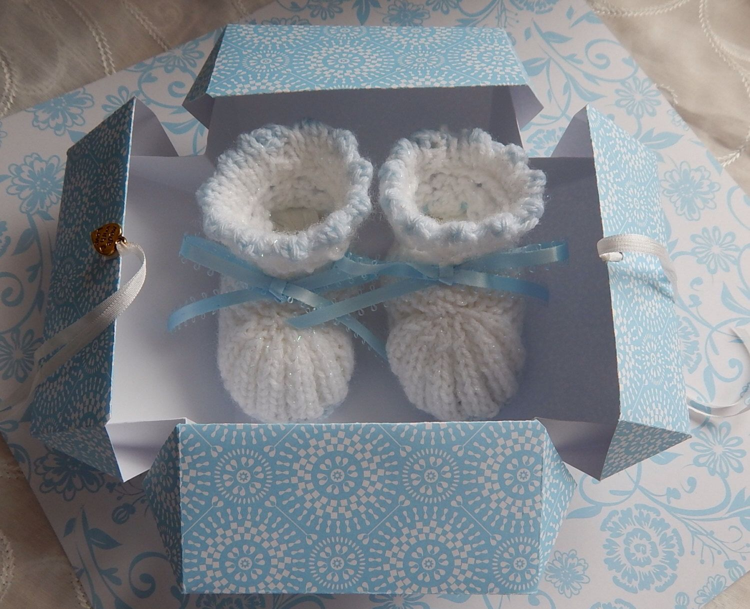 A personal favourite from my Etsy shop https://www.etsy.com/uk/listing/190861648/handmade-baby-booties-baby-gift-set-gift