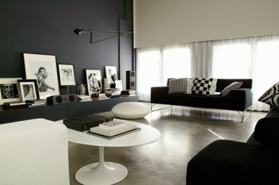 :: INTERIORS :: the use of black and white, well done, Max Zambelli, featured on Elle Decore Italy, The user-friendly area, with sofas Mos, is illuminated by a sequence of horizontal windows that cut through the perimeter wall. Despite the industrial character of the area the atmosphere is intimate and comfortable to photos copyright, pillows and objects. #interiors