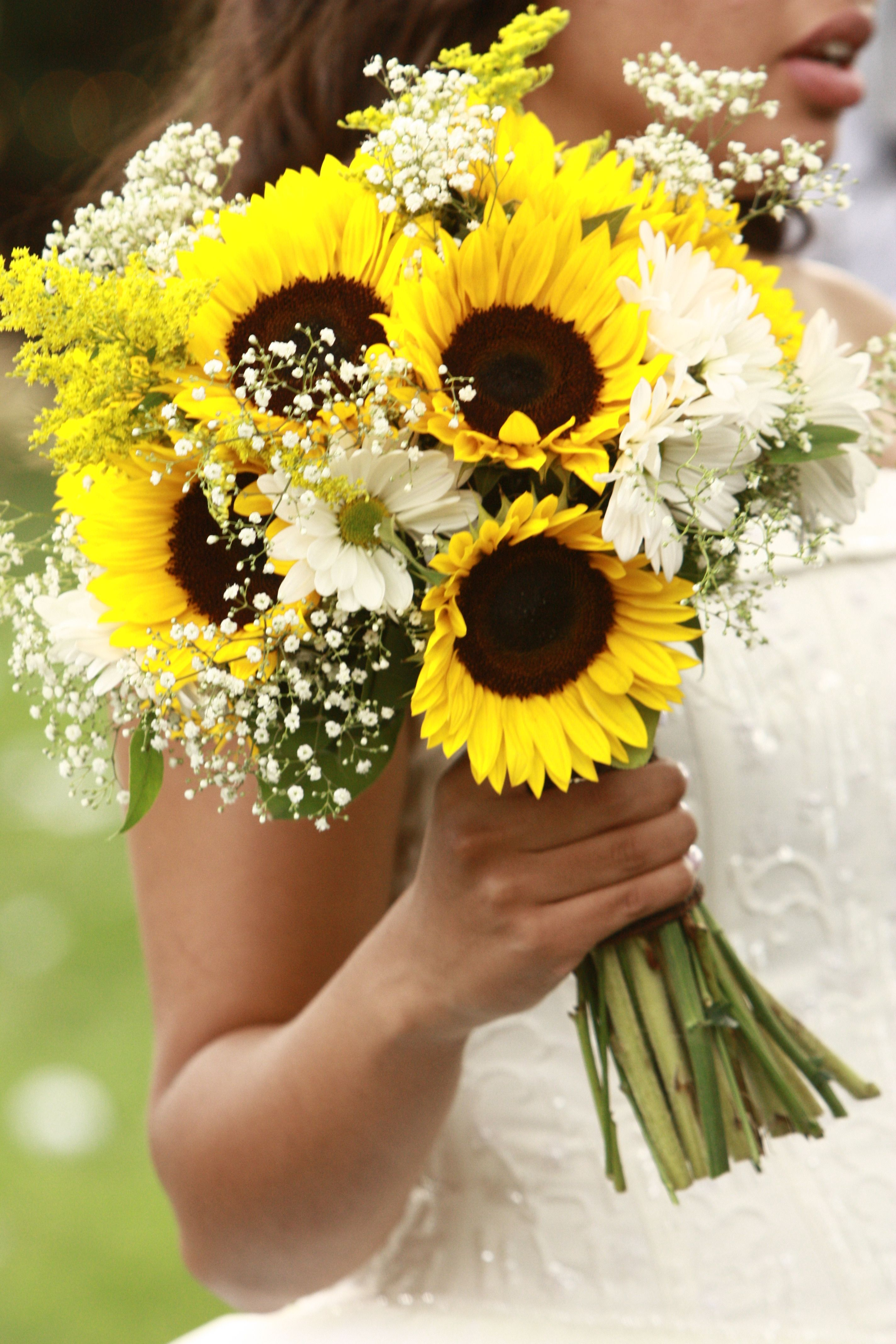 Yellow bridal bouquet with sunflowers and babys breath