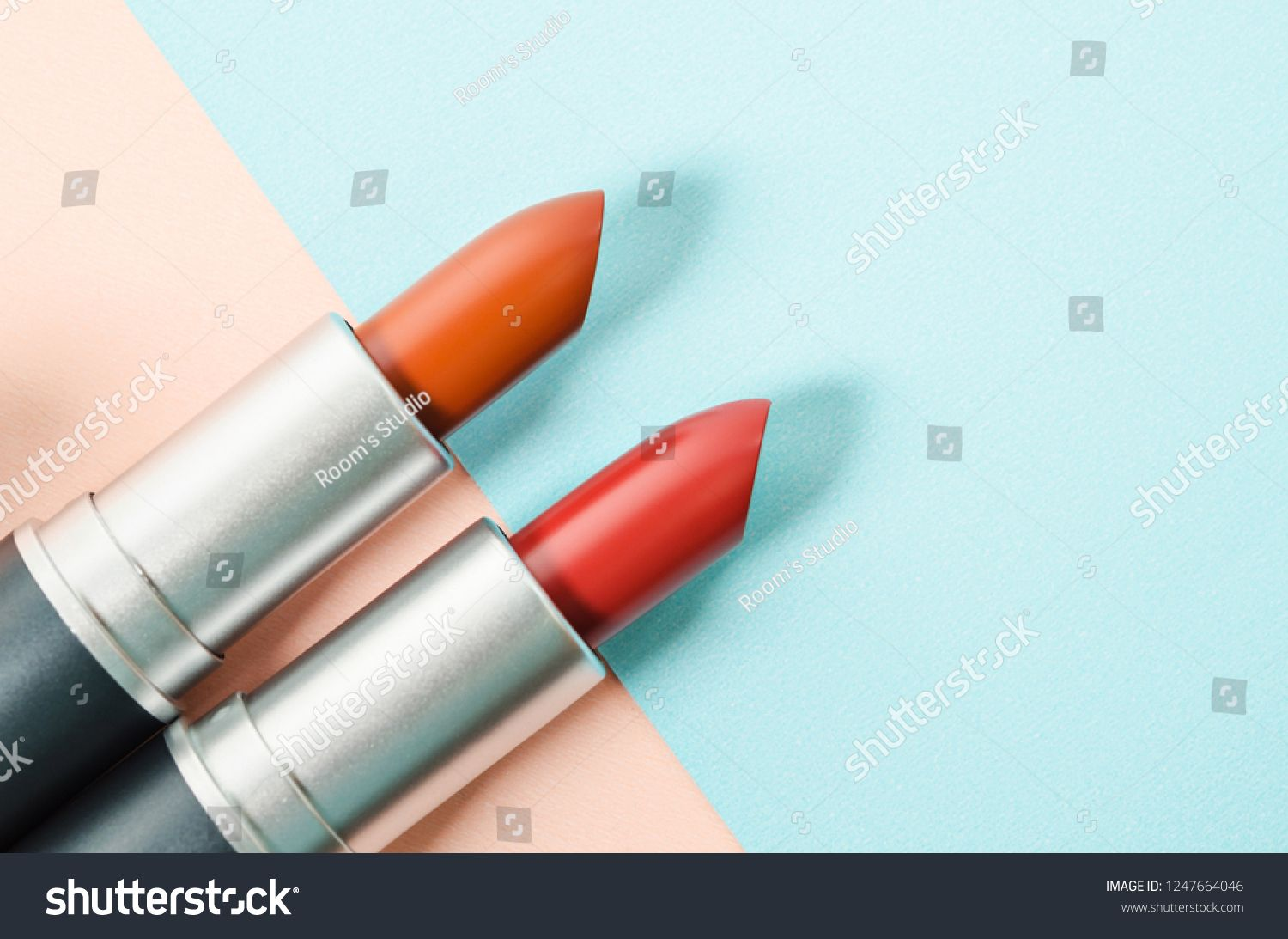Lipstick. Fashion Colorful Lipsticks over beautiful background with free space for text or your mes