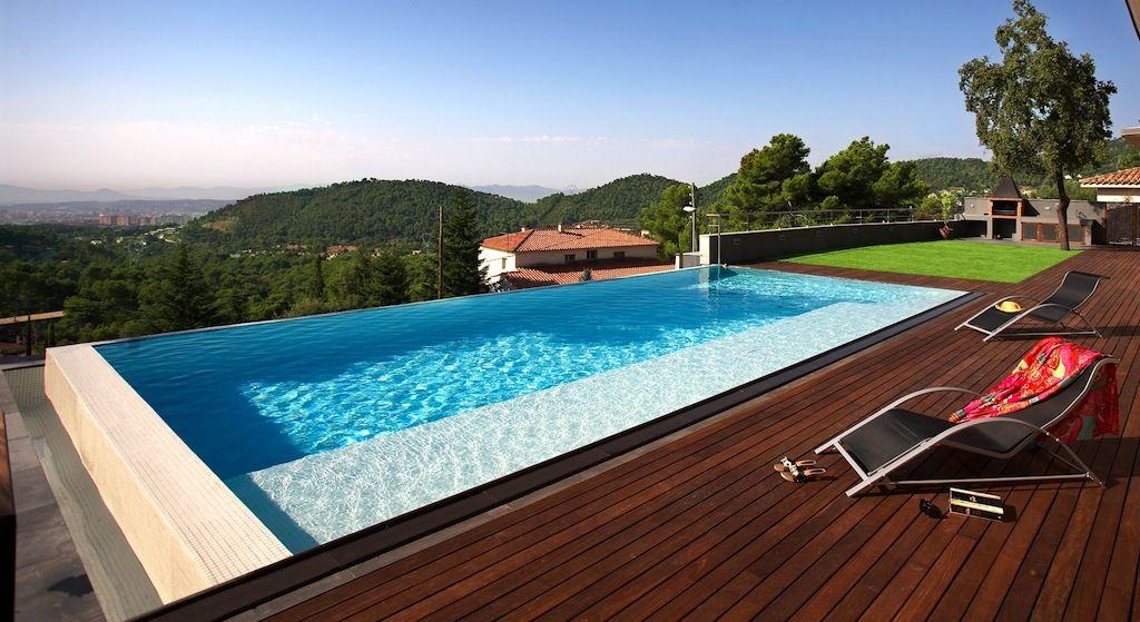 Piscina desbordante con tarima so ar es gratis for Sonar con piscina
