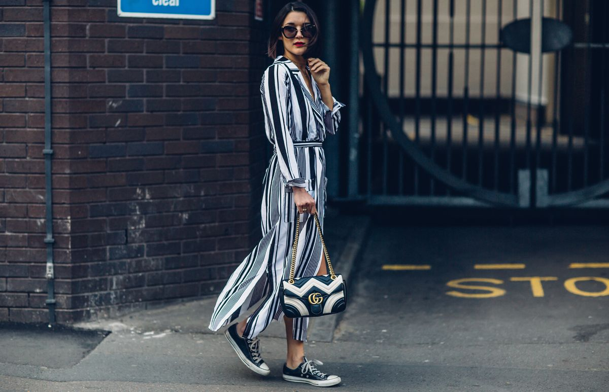 Anisa Sojka styles black and white Boohoo striped wrap maxi dress | Chuck Taylor Converse sneakers | Gucci GG Marmont matelassé shoulder bag with gold chain | Red lipstick | Brunette short bob hairstyle | Fashion blogger street style shot in London by Moeez Ali