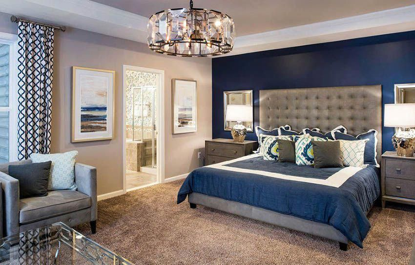 Master bedroom with tan paint and dark blue walls # ...