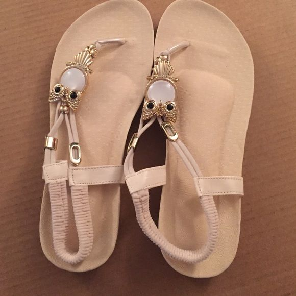 Flat nude colored sandals Flat sandals with rose gold and owl detail. Shoes Sandals