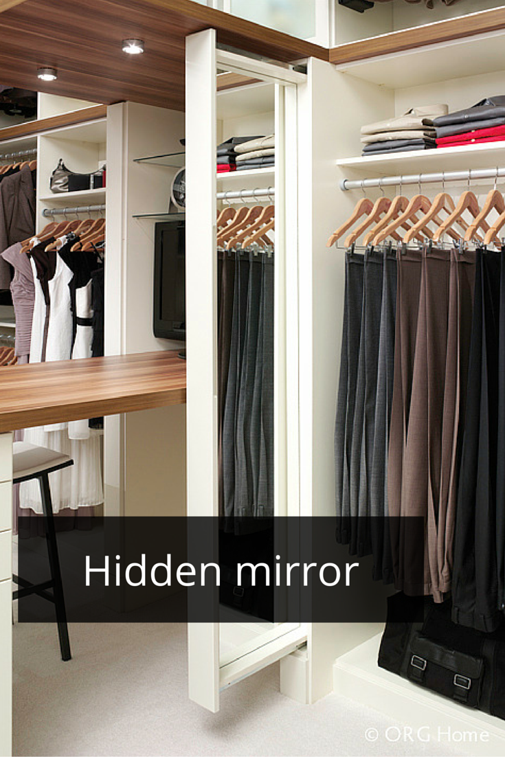 a slide out mirror in a custom laminate closet organizer system click through to learn the difference between wire and laminate for a closet system