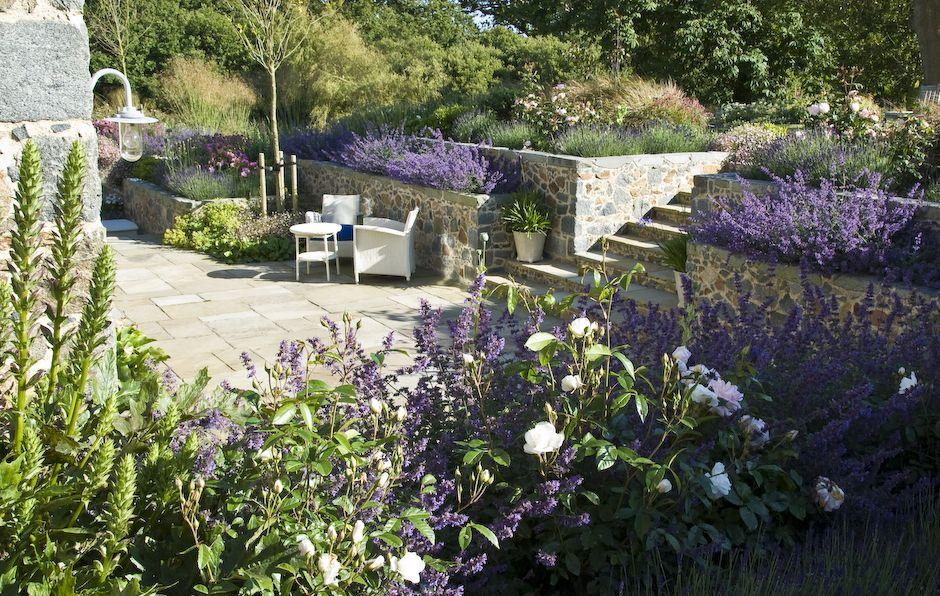 Relaxed Family Garden Design For Recently Converted Farmhouse In Guernsey With Granite Retaining Walls Roses Nepe Modern Garden Dream Garden Landscape Design