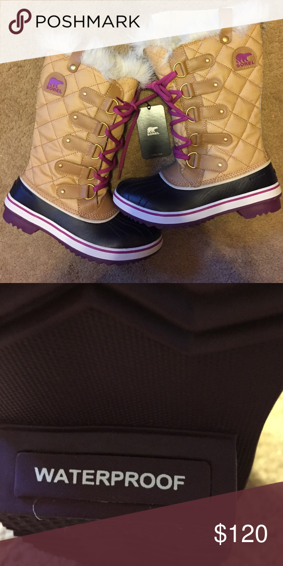 Sorel waterproof boots Waterproof boots w/ magenta accent. Never been worn. Tags still attached Sorel Shoes Winter & Rain Boots