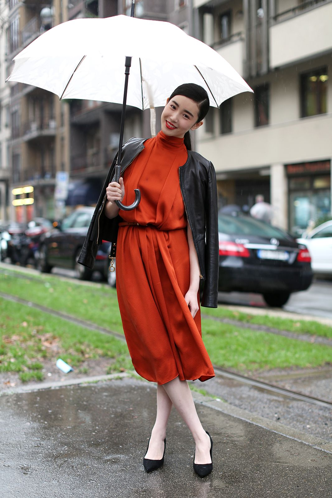 The European Guide To Flawless Style #refinery29  http://www.refinery29.com/milan-fashion-week#slide10  Note to self: Buy an all-white umbrella. How striking does this one look?