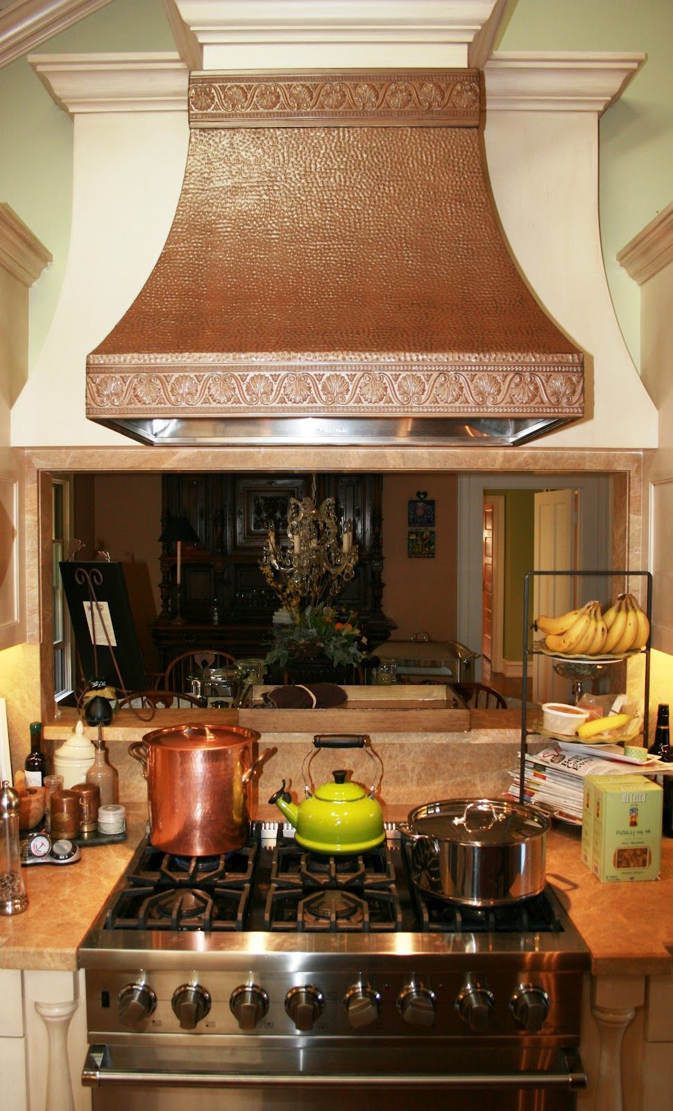 kitchen pass through over stove | copper embossed hood caps off ...