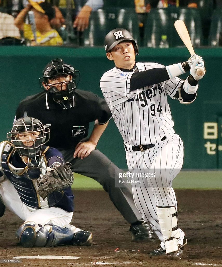 Fumihito Haraguchi hits a two-run home run in the eighth inning of the Hanshin Tigers' 2-0 win over the Orix Buffaloes in interleague play at Koshien Stadium on June 20, 2016