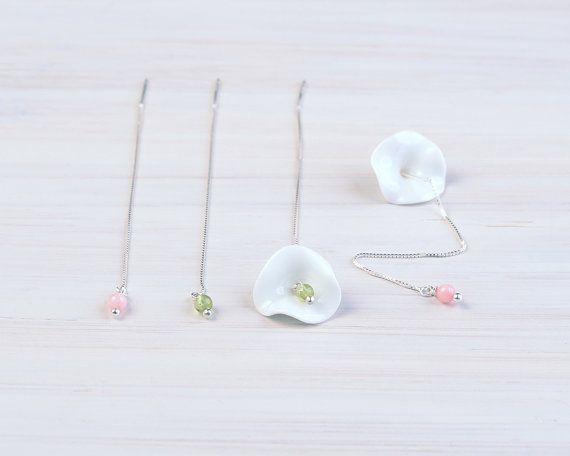 #boohua ceramic datura flower thread earrings. $38.0