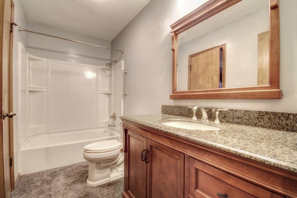 Traditional Full Bathroom with High ceiling, Oval Ceramic Undermount Bathroom Sink in Biscuit by Ronbow, Carpet, Flush