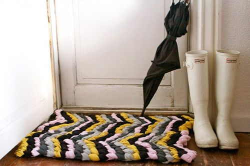 it's not really sewing, and it's not really knit and crochet, it's a friendship bracelet rug. I'm thinking a few packs of inexpensive white men's tees, some rit dye and this might be near my front door