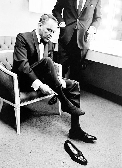 "FS puts on the black patent leather shoes he called ""Mary Janes"" in his dressing room at the Sands Hotel & Casino, 1964"