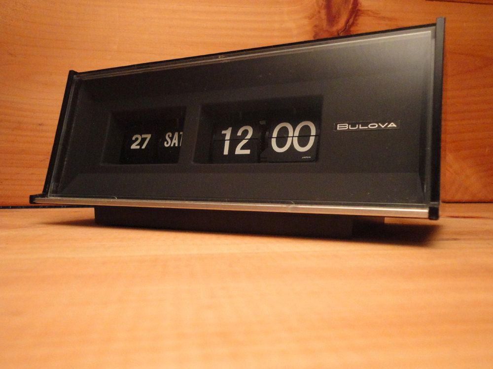 BULOVA Flip Digit Clock Day & Date Mid-Century Eames Era Mad Men 1960s 1970s Solid State Made in Japan Flip / Digit Numbers Rare Minty by AntiqueApartment on Etsy https://www.etsy.com/listing/216381720/bulova-flip-digit-clock-day-date-mid