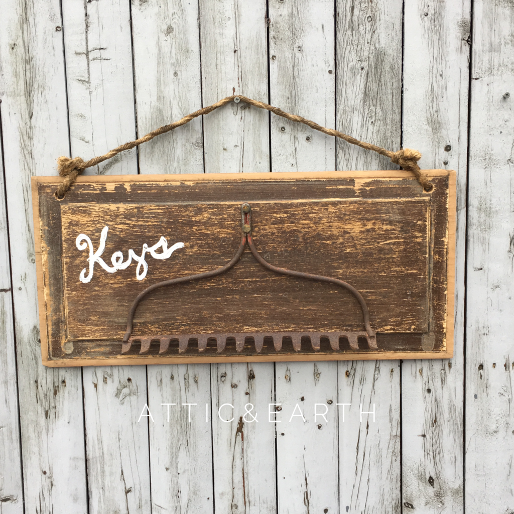 This rustic key holder was made using recycled materials and will add charm  to your space