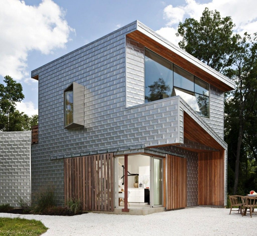 Love the steely look of the aluminium cladding contrasted by the warmth of the wood!