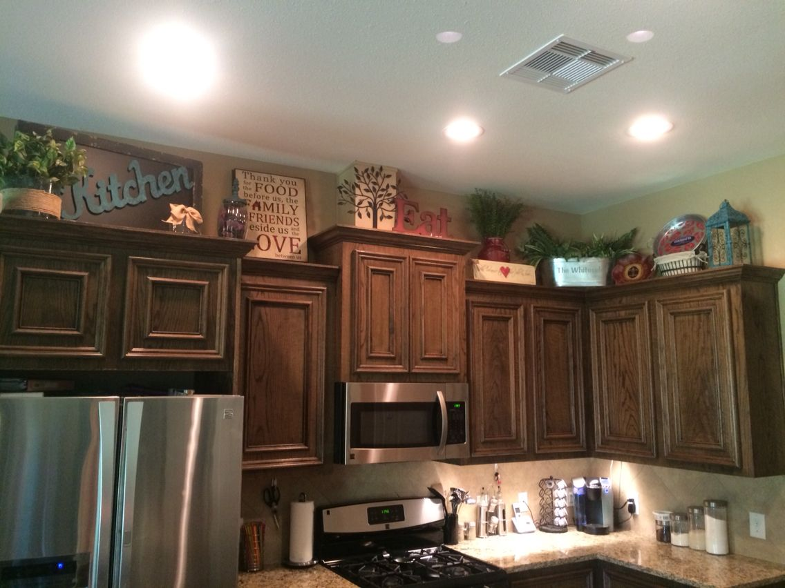 Above Kitchen Cabinets Decor Decorating Above Kitchen Cabinets