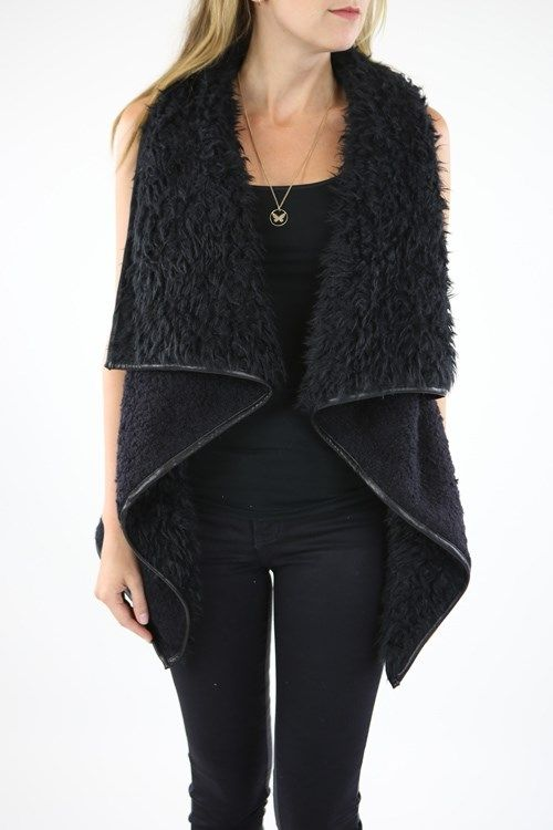 Everyone's favorite vest of the season! Amazing quality fur vest with faux leather trim and detail on pockets. Shearling and fur combine together to make an fab statement piece! We love it with plaid and jeans or even over a dress!COLORSTanBlackSIZESSmall (0-4)Medium (6-8)Large (10-12)XL (12-14)