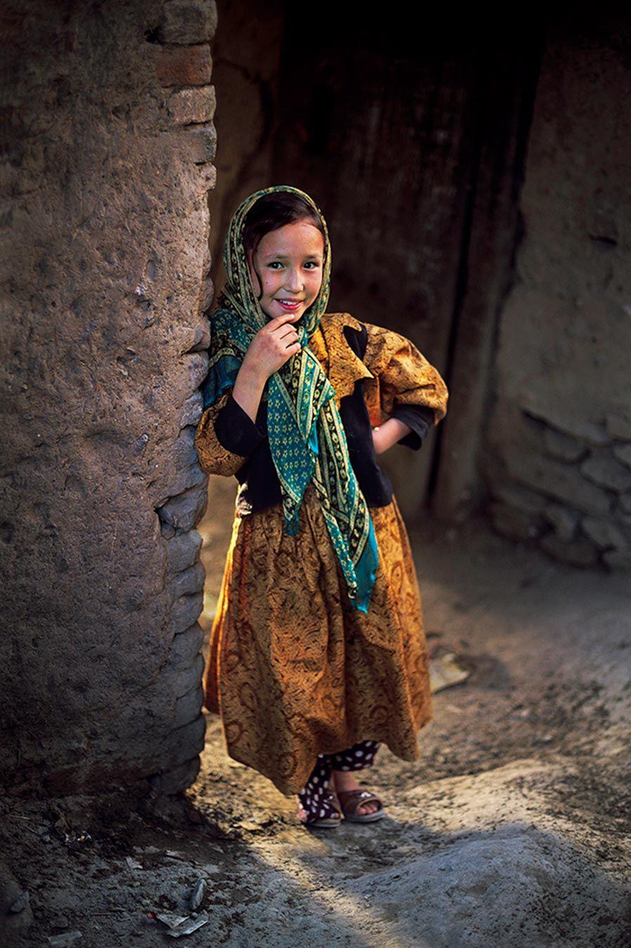 Fine Art Prints | Steve McCurry smiling girl in Afghan