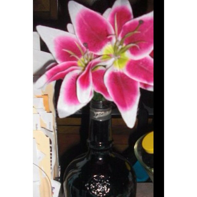 A few silk flowers in a bottle I found out on the farm
