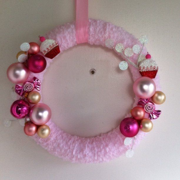 https://flic.kr/p/8YmHPv   Perfect in pink   yarn wreath, wrapped and adorned with bubblegum pink, cream, and cupcake ornaments,  blogged @ www.goldiloks.blogspot.com