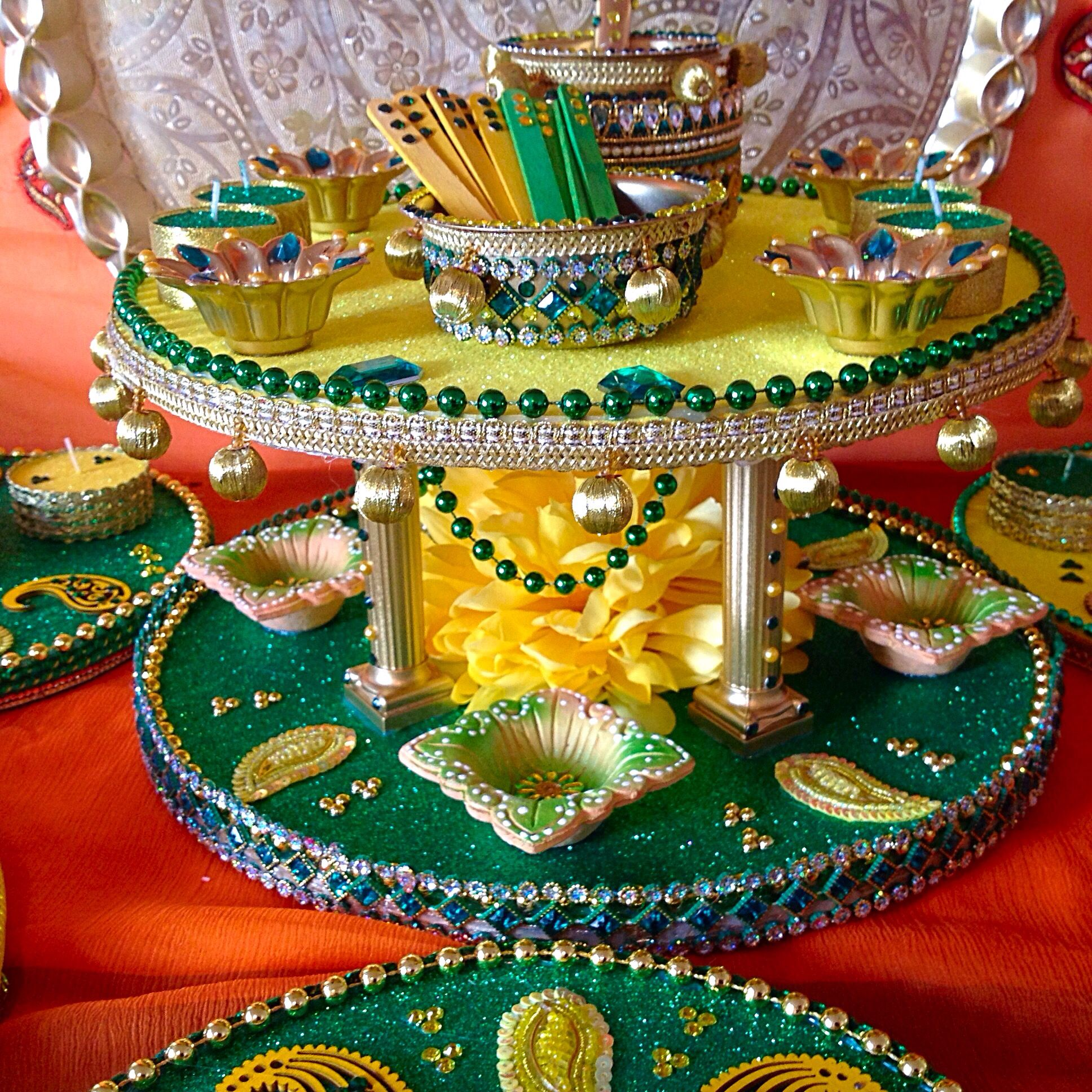 A Double Tiered Mehndi Plate In Traditional Colours An Oil And
