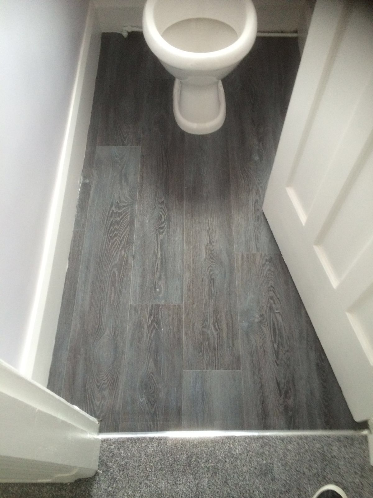Dark Grey Laminate Effect Vinyl Floor Fitted To A Small Downstairs Toiliet Vinyl Flooring Home Carpet Grey Laminate